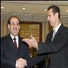 upload/image/قديم/نوري المالكي وبشار الاسد ماسك ايده.jpg